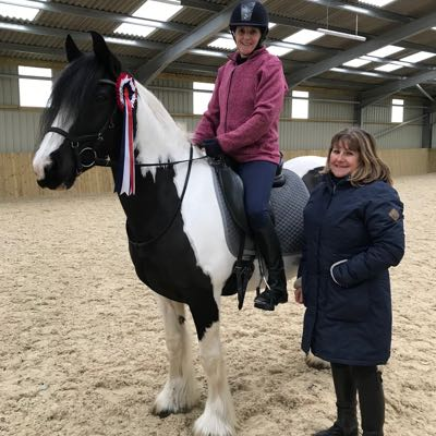 Horse and rider with online dressage champion rosette