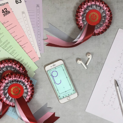 rosettes, iphone and dressage test sheets