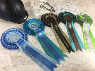 Riding hat, spurs, stock, score sheets and five Championship Show rosettes