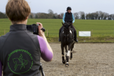 Person filming online dressage